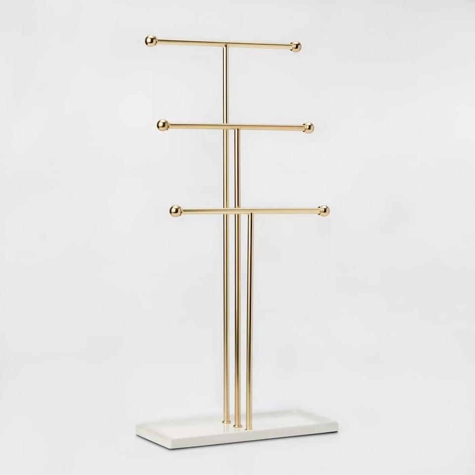 <p>Hang bracelettes, bangles, watches, chokers, necklaces and more with the <span>Trigem Jewelry Storage Stand Brass - Umbra</span> ($20). You can even hang your fresh face masks.</p>