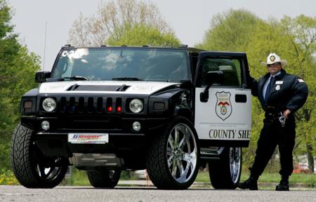 This 700-horsepower Hummer H2 with 28-inch rims is used by Texas sheriffs. It's powered by a 7.0L supercharged V8 engine.