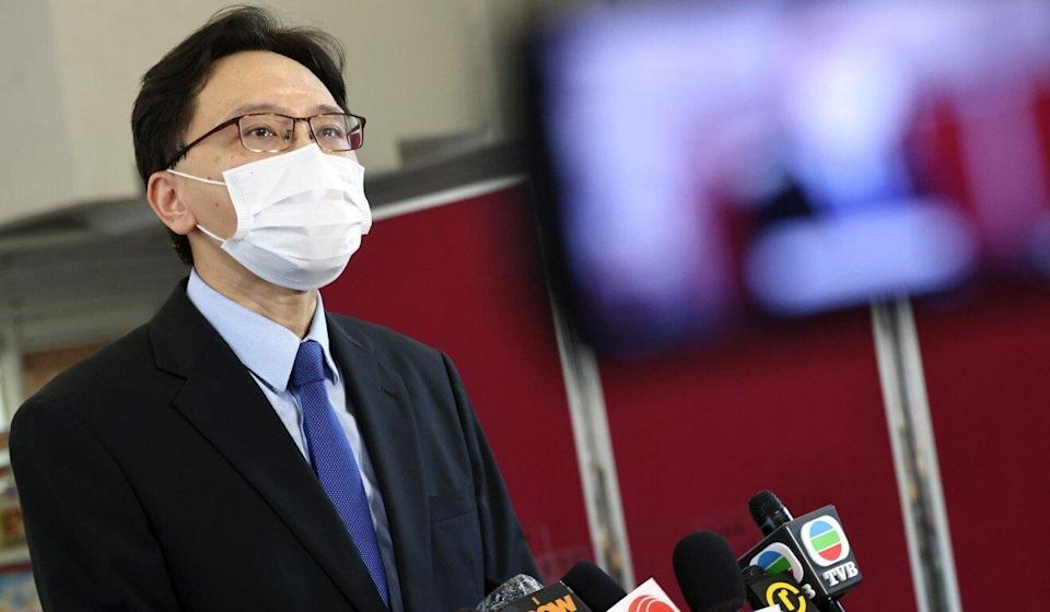 Ho Ngai College principal Jackson Cheung speaks to reporters on Monday morning. Photo: K. Y. Cheng