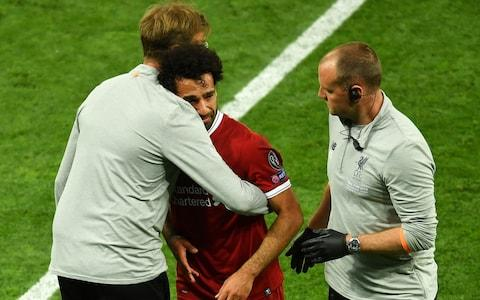 Jurgen Klopp hugs a distressed Mo Salah - Credit: Mike Hewitt/Getty Images