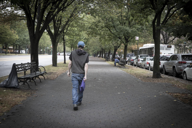 David Shohl walks along a paved path along the Eastern Parkway in Brooklyn. (Photo: Gordon Donovan/Yahoo News)