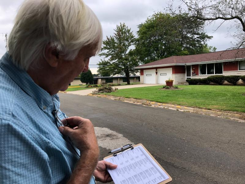 Democratic organizer Bill Chandler reviews his voter contact sheet while canvassing on Saturday, Sept. 21, 2019, in Whitewater, Wis.  Chandler is executing the Democratic strategy to win back Wisconsin _ a block-by-block rebuilding of the infrastructure they let crumble ahead of the last presidential election. Many Democrats in Wisconsin, and across the Rust Belt states that President Donald Trump flipped Republican in 2016, believe their weak neighborhood network contributed to their defeat.  (AP Photo/Scott Bauer)