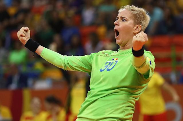 <p>Paula Ungureanu of Romania celebrates during the Womens Preliminary Group A match between Romania and Montenegro at Future Arena on August 10, 2016 in Rio de Janeiro, Brazil. (Photo by Lars Baron/Getty Images) </p>