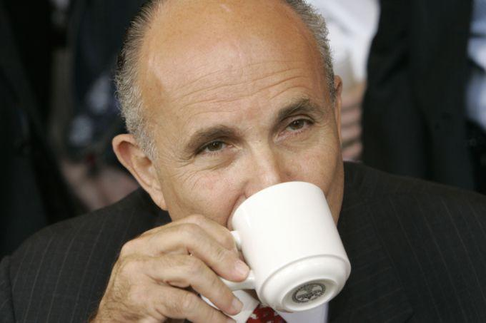 Republican presidential hopeful Rudy Giuliani discusses politics with supporters over a cup of coffee during a visit to Broadway Grill in Burlingame, Calif., Wednesday, May 30, 2007. (AP/Marcio Jose Sanchez)