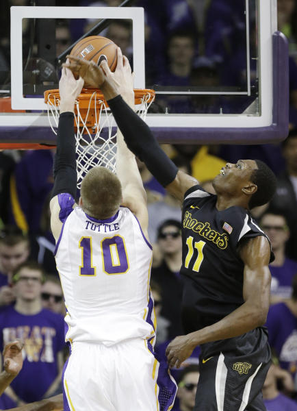 Wichita State forward Cleanthony Early, right, tries to block a shot by Northern Iowa forward Seth Tuttle during the first half of an NCAA college basketball game on Saturday, Feb. 8, 2014, in Cedar Falls, Iowa. (AP Photo/Charlie Neibergall)
