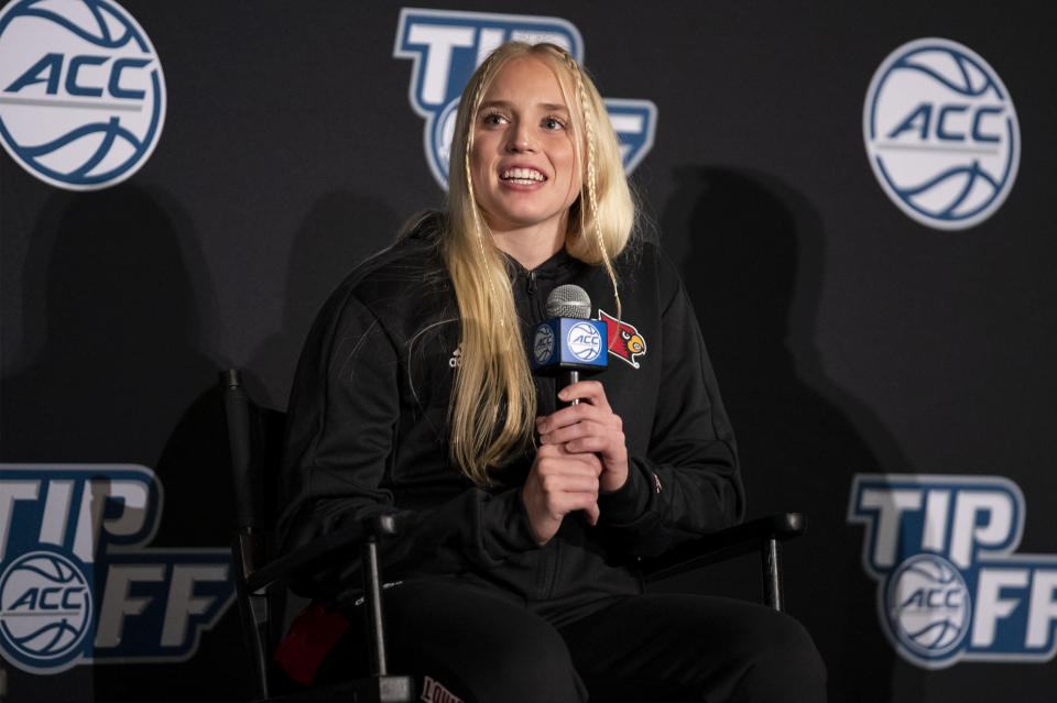 Louisville guard Hailey Van Lith smiles during NCAA college basketball Atlantic Coast Conference media day, Wednesday, Oct. 13, 2021, in Charlotte, N.C. (AP Photo/Matt Kelley)