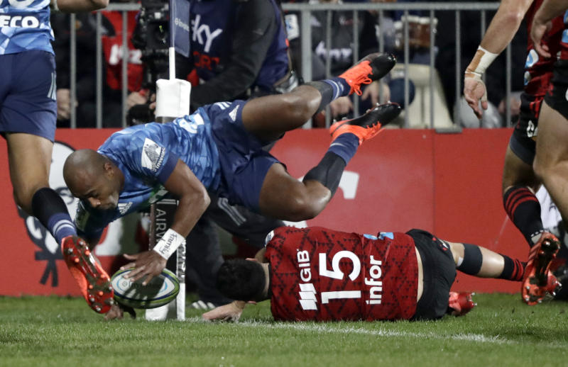 Blues Mark Telea scores his team's first try during the Super Rugby Aotearoa rugby game between the Crusaders and the Blues in Christchurch, New Zealand, Saturday, July 11, 2020. (AP Photo/Mark Baker)