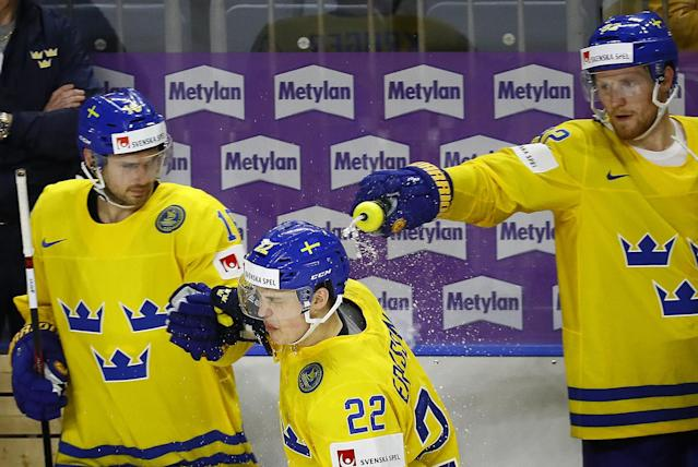 <p>Gabriel Landeskog of Sweden pours water over his team mate Joel Eriksson Ek who scored a goal, at the 2017 IIHF World Championship on May 12, 2017. (Photo: Wolfgang Rattay/Reuters) </p>