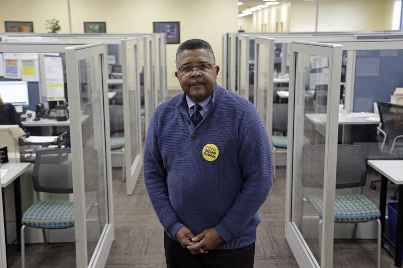 In this photo taken Wednesday, Dec. 18, 2019 Dennis Gaddy, the co-founder of Community Success Initiative is shown at the Raleigh, N.C. office. Gaddy, 62, served time behind bars and said he was unable to vote for seven years after being released from prison because he was on probation. (AP Photo/Gerry Broome)