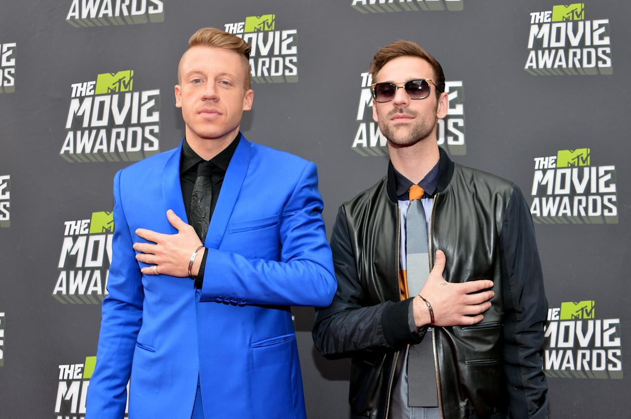 CULVER CITY, CA - APRIL 14:  Musicians Macklemore (L) and Ryan Lewis arrive at the 2013 MTV Movie Awards at Sony Pictures Studios on April 14, 2013 in Culver City, California.  (Photo by Alberto E. Rodriguez/Getty Images)