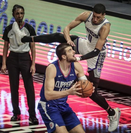 Clippers center Ivica Zubac is fouled by Sacramento Kings guard Tyrese Haliburton on Jan. 20 at Staples Center.