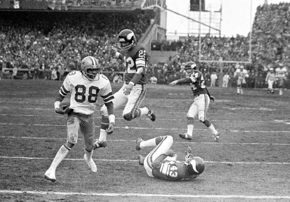 FILE - In this Dec. 28, 1975, file photo, Dallas Cowboy wide receiver Drew Pearson (88) nears the end zone on a game-winning 50-yard touchdown pass play in the fourth quarter of an NFL football game against the Minnesota Vikings in Bloomington, Minn. Pearson is headed to the Pro Football Hall of Fame as part of the class of 2021 after the disappointment of not getting in a year earlier. The former Cowboys receiver joins 1970s-era offensive teammates Roger Staubach and Tony Dorsett in the hall. (AP Photo/File)