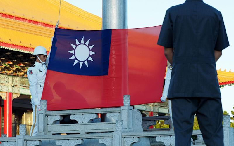 Soldiers perform a flag-raising ceremony in Taiwan - REX