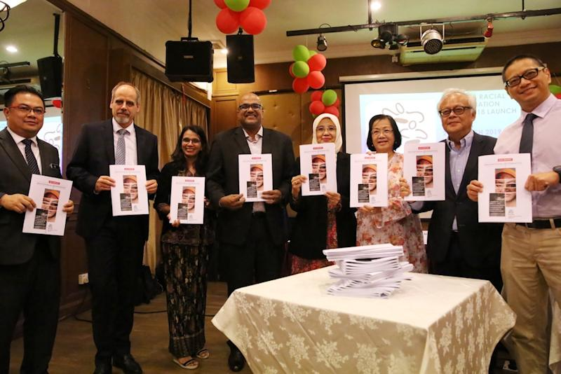 Panellists hold copies of Pusat Komas' 2018 Malaysia Racial Discrimination report during its launch in Kuala Lumpur March 21, 2019. — Picture by Choo Choy May