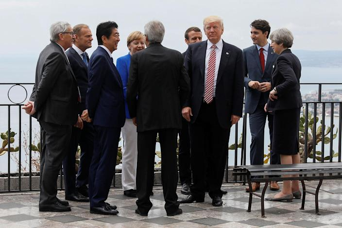 <p>President Donald Trump gathers with (L-R) European Commission President Jean-Claude Juncker, European Council President Donald Tusk, Japanese Prime Minister Shinzo Abe, German Chancellor Angela Merkel, Italian Prime Minister Paolo Gentiloni, French President Emmanuel Macron, Canadian Prime Minister Justin Trudeau and Britainís Prime Minister Theresa May as they attend the G7 Summit in Taormina, Sicily, Italy, May 26, 2017. (Photo: Jonathan Ernst/Reuters) </p>