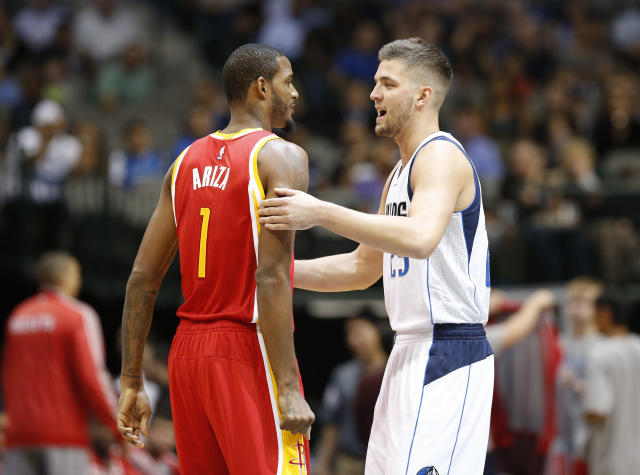 Oct 7, 2014; Dallas, TX, USA; Dallas Mavericks forward Chandler Parsons (25) hugs Houston Rockets forward Trevor Ariza (1) prior to the game at American Airlines Center. (Matthew Emmons-USA TODAY Sports)