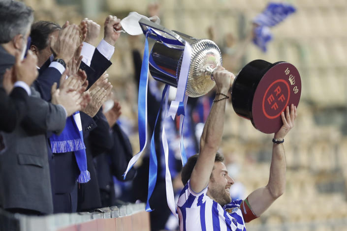 Real Sociedad's Martin Zubimendi celebrates with the trophy after winning the final of the 2020 Copa del Rey, or King's Cup, soccer match between Athletic Bilbao and Real Sociedad at Estadio de La Cartuja in Sevilla, Spain, Saturday April 3, 2021. The game is the rescheduled final of the 2019-2020 competition which was originally postponed due to the coronavirus pandemic. (AP Photo/Angel Fernandez)