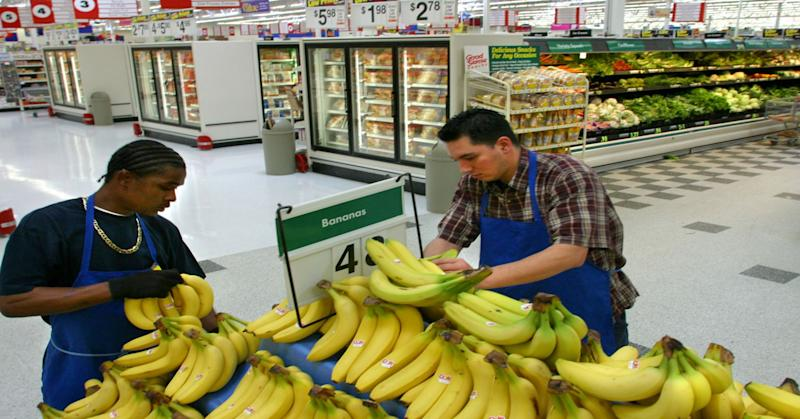 Wal-Mart employees restock fresh produce at a Walmart store in Denver area.