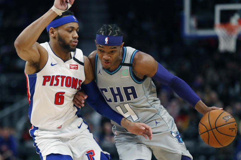 Charlotte Hornets guard Devonte' Graham (4) drives on Detroit Pistons guard Bruce Brown (6) during the second half of an NBA basketball game, Monday, Feb. 10, 2020, in Detroit. (AP Photo/Carlos Osorio)