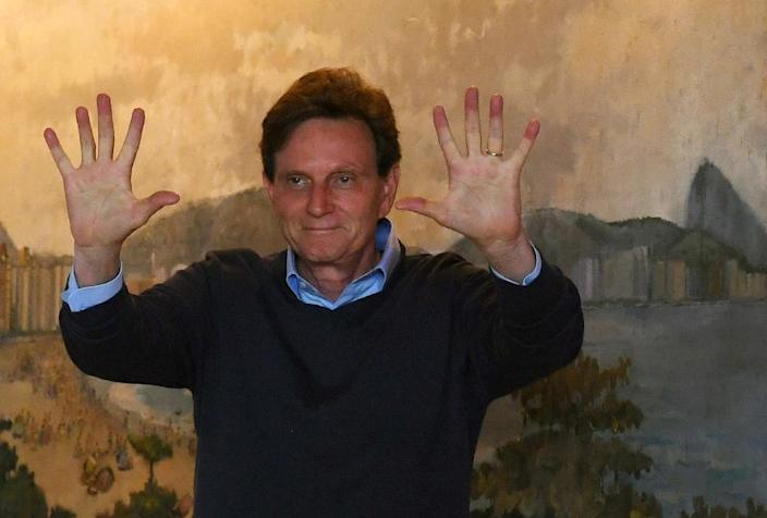 Marcelo Crivella of the Brazilian Republican Party has promised to crack down on violent crime and is favourite to win Rio's mayoral election (AFP Photo/Vanderlei Almeida)