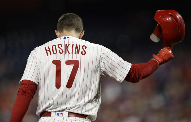 Philadelphia Phillies' Rhys Hoskins tosses his helmet after pop-fouling out against Washington Nationals starting pitcher Stephen Strasburg during the fifth inning of a baseball game, Wednesday, Sept. 12, 2018, in Philadelphia. Washington won 5-1. (AP Photo/Matt Slocum)