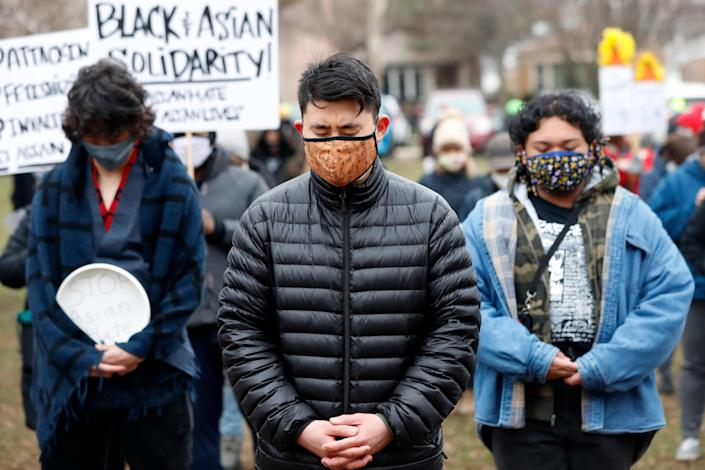 People stand in solidarity during a vigil and rally against Asian hate crimes, Friday, March 26, 2021, at Chicago's Horner Park. The event is organized by local Chicago organizations led by Asian Americans and Pacific Islanders. (AP Photo/Shafkat Anowar) ORG XMIT: ILSA106