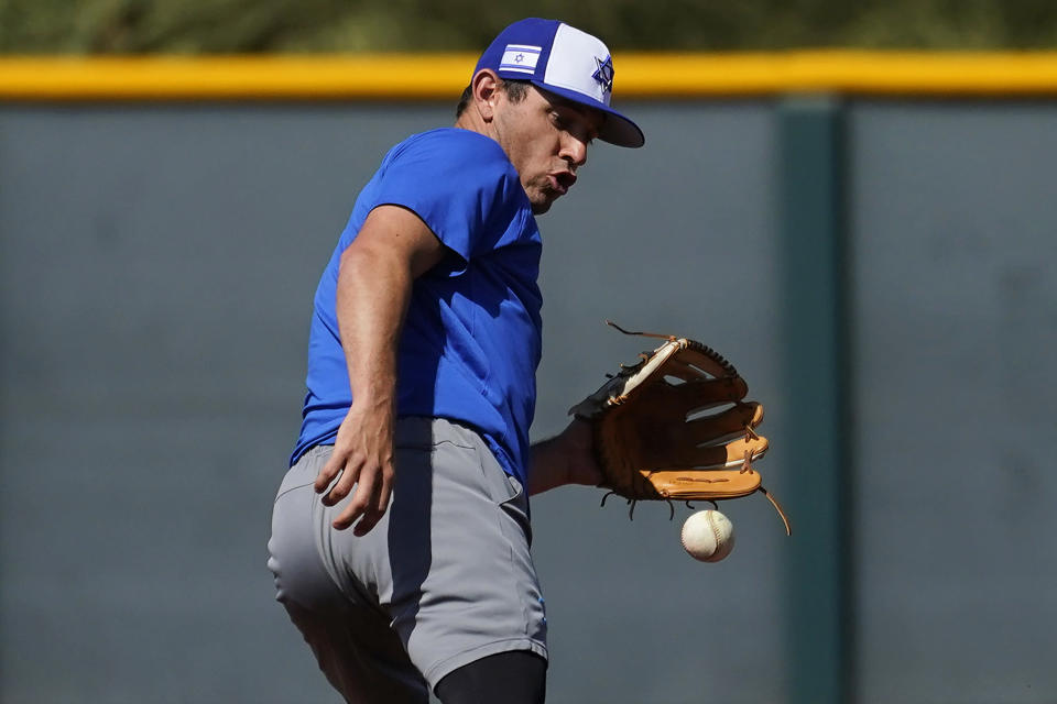 Israel Olympic baseball player Ian Kinsler takes fielding practice at Salt River Fields spring training facility, Wednesday, May 12, 2021, in Scottsdale, Ariz. Israel has qualified for the six-team baseball tournament at the Tokyo Olympic games which will be its first appearance at the Olympics in any team sport since 1976. (AP Photo/Matt York)