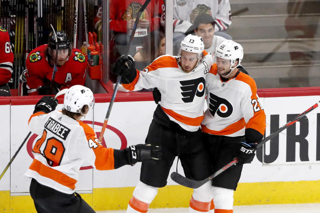 Philadelphia Flyers' Kevin Hayes, center, celebrate his goal with teammates Scott Laughton, right, and Joel Farabee during the third period of an NHL hockey game against the Chicago Blackhawks on Thursday, Oct. 24, 2019, in Chicago. (AP Photo/Charles Rex Arbogast)