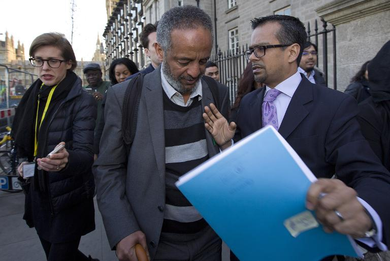 Hussen Abase (C), father of Amira Abase leaves the House of Commons Home Affairs Committee, in central London on March 10, 2015 (AFP Photo/Justin Tallis)