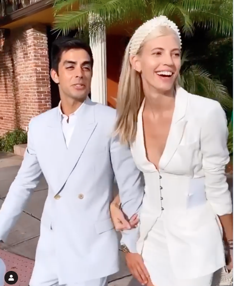 Devon Windsor in white suit getting her wedding marriage licence