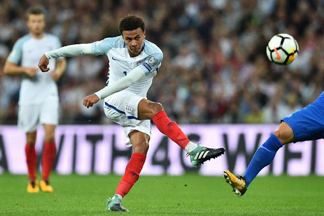 Television footage showed Tottenham midfielder Alli making a middle-finger salute shortly after a collision with Slovakia's Martin Skrtel (AFP Photo/Glyn KIRK )