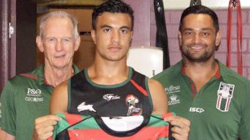 Joseph Suaalii is seen here with Rabbitohs coach Wayne Bennett and club legend John Sutton.