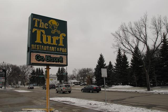 This sign outside The Turf bar across the street from the North Dakota State University campus on Friday, March 21, 2014, highlights the support for the Bison men's basketball team, which won its first NCAA Division I tournament game Thursday and will play Saturday for a spot in the Sweet 16. (AP Photo/Dave Kolpack)