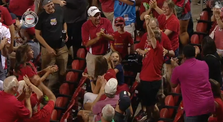 This ingenious Cardinals fan caught a foul ball in her purse. (MLB.com)