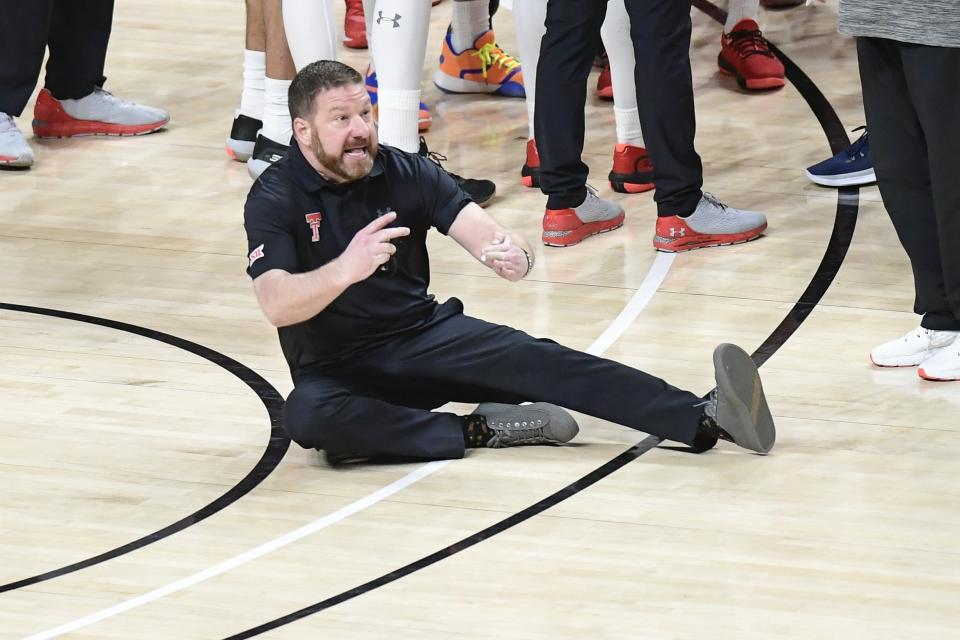 Texas Tech head coach Chris Beard reacts to his second technical foul during the final seconds of the second half of an NCAA college basketball game against West Virginia in Lubbock, Texas, Tuesday, Feb. 9, 2021. (AP Photo/Justin Rex)