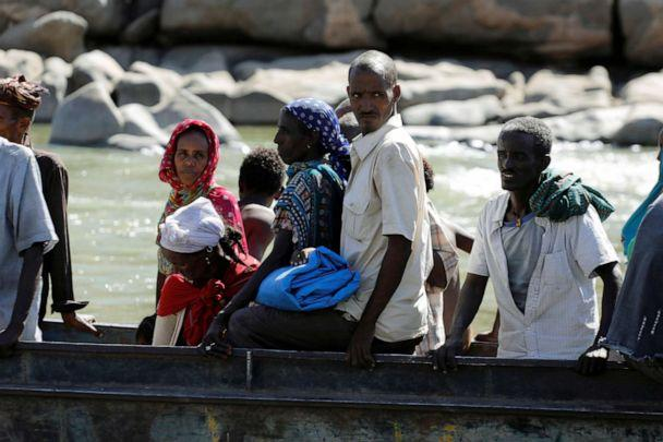 PHOTO: Ethiopians fleeing from the Tigray region arrive by boat to Sudan after crossing a river between the two countries, near the Hamdeyat refugees transit camp, Dec. 1, 2020.  (Baz Ratner/Reuters)