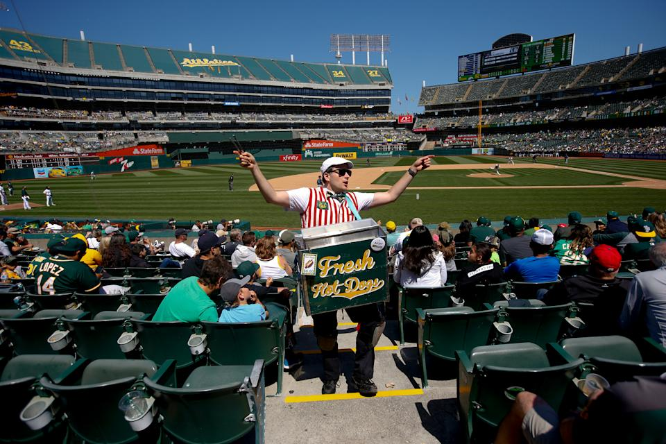 OAKLAND, CA - MAY 25: A hot dog vendor sells hot dogs in the stands during the game between the Oakland Athletics and the Seattle Mariners at the Oakland-Alameda County Coliseum on May 25, 2019 in Oakland, California. The Athletics defeated the Mariners 6-5. (Photo by Michael Zagaris/Oakland Athletics/Getty Images)