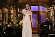 """<p>For the Emma star's opening monologue, she wore a feather-embellished, silver Peter Do gown with Tiffany & Co jewellery. </p><p><a class=""""link rapid-noclick-resp"""" href=""""https://www.youtube.com/watch?v=DhSz9aPiBe0&ab_channel=SaturdayNightLive"""" rel=""""nofollow noopener"""" target=""""_blank"""" data-ylk=""""slk:WATCH ANYA TAYLOR-JOY'S MONOLOGUE HERE"""">WATCH ANYA TAYLOR-JOY'S MONOLOGUE HERE</a></p>"""