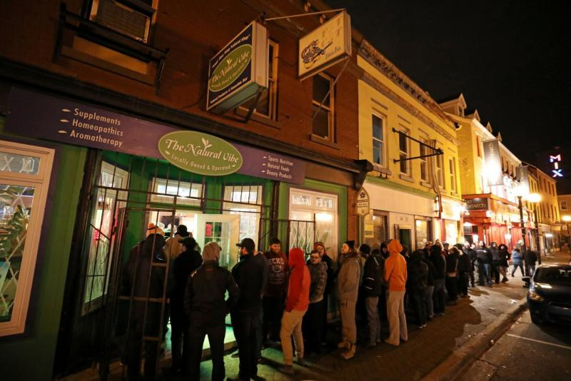 Customers line up outside the Natural Vibe store after legal recreational marijuana went on sale in St John's, Newfoundland (Chris Wattie/Reuters)