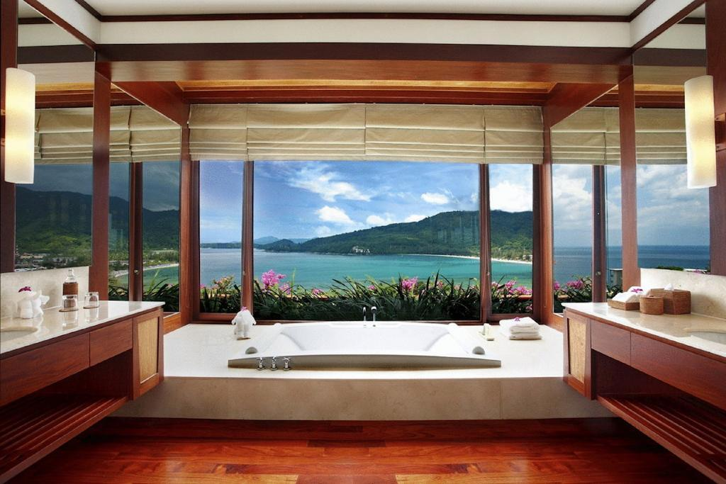 """<p>Located on the west coast of Phuket in Thailand, the <a rel=""""nofollow"""" href=""""https://www.booking.com/hotel/th/andara-resort-residences.en-gb.html?label=gen173nr-1DCAEoggJCAlhYSDNiBW5vcmVmaFCIAQGYAS64AQbIAQzYAQPoAQGSAgF5qAID;sid=3a2a3416e89e08236fe2947256c10124;all_sr_blocks=17641005_96439764_0_1_0;checkin=2017-11-27;checkout=2017-11-29;dest_id=-3414444;dest_type=city;dist=0;group_adults=2;hapos=1;highlighted_blocks=17641005_96439764_0_1_0;hpos=1;room1=A%2CA;sb_price_type=total;srepoch=1510056389;srfid=1816dd53257efa3166c51a542c770376fa79cb17X1;srpvid=6b9c552135cb001e;type=total;ucfs=1&#hotelTmpl"""">Andara Resort</a> features a bathroom overlooking Kamala Beach, the Andaman Sea and lush green mountains. The resort also throws in a private chef for good measure.</p>"""