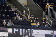 Fans cheer during the second period of an NHL hockey game between the Boston Bruins and the New York Islanders at TD Garden, Monday, May 10, 2021, in Boston, has moved to the next step in its COVID-19 reopening plan, allowing large indoor and outdoor venues, including TD Garden, Fenway Park and Gillette Stadium to increase fan capacity from 12% to 25%. (AP Photo/Elise Amendola)