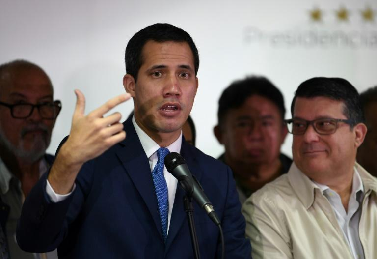 Venezuelan opposition leader and self-proclaimed acting president Juan Guaido insists he will lead a parliamentary session from the National Assembly on Tuesday (AFP Photo/YURI CORTEZ)