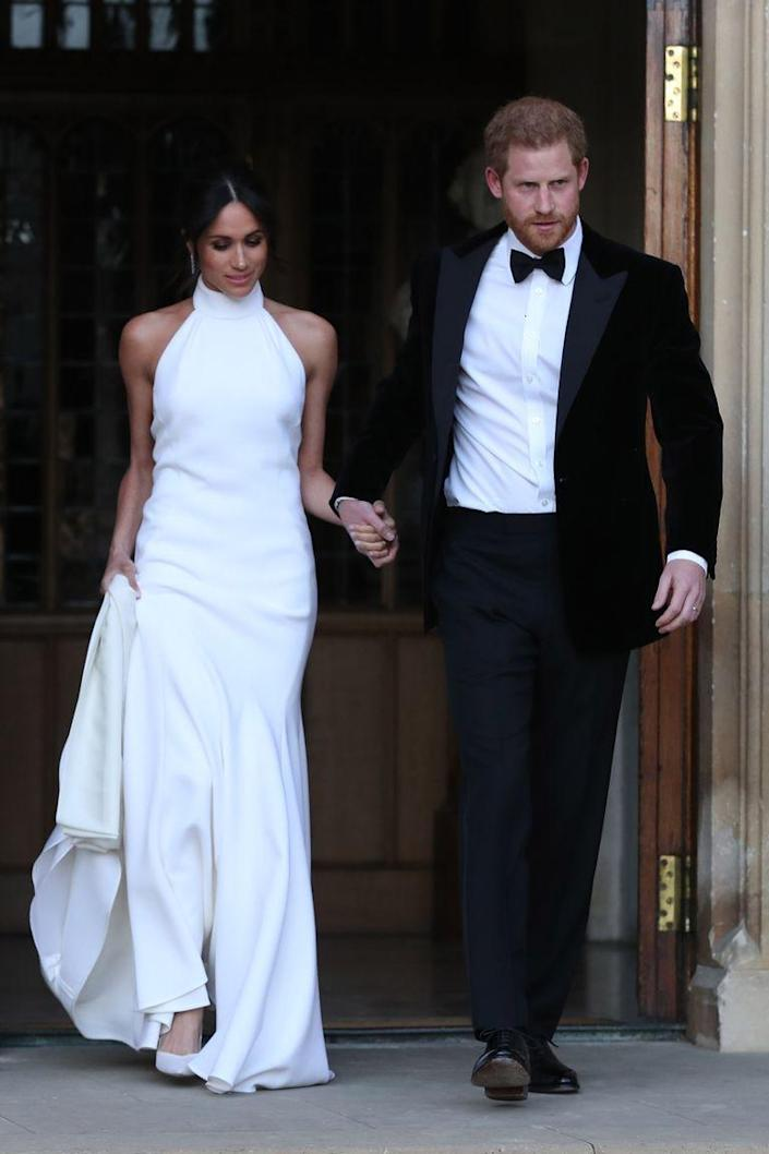 """<p>Like many other royal brides, Meghan Markle changed into a second wedding dress to attend her wedding reception when she married Prince Harry in May 2018. The Duchess changed into a bespoke <a href=""""https://www.townandcountrymag.com/society/tradition/a20759645/meghan-markle-royal-wedding-reception-dress-photos/"""" rel=""""nofollow noopener"""" target=""""_blank"""" data-ylk=""""slk:lily white gown by Stella McCartney"""" class=""""link rapid-noclick-resp"""">lily white gown by Stella McCartney</a> featuring a high neck.</p>"""
