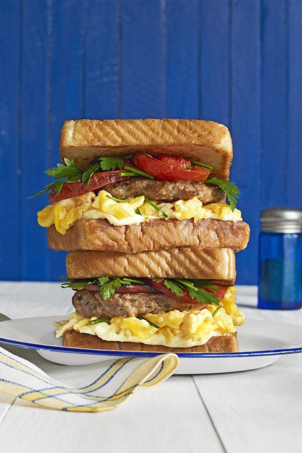 """<p>Stacked high, these breakfast sandwiches have everything Dad is craving: sausage, eggs, and roasted tomatoes!<strong><a href=""""https://www.countryliving.com/food-drinks/recipes/a41634/loaded-breakfast-sandwiches-recipe/"""" rel=""""nofollow noopener"""" target=""""_blank"""" data-ylk=""""slk:"""" class=""""link rapid-noclick-resp""""><br></a></strong></p><p><strong><a href=""""https://www.countryliving.com/food-drinks/recipes/a41634/loaded-breakfast-sandwiches-recipe/"""" rel=""""nofollow noopener"""" target=""""_blank"""" data-ylk=""""slk:Get the recipe"""" class=""""link rapid-noclick-resp"""">Get the recipe</a>.</strong> </p>"""