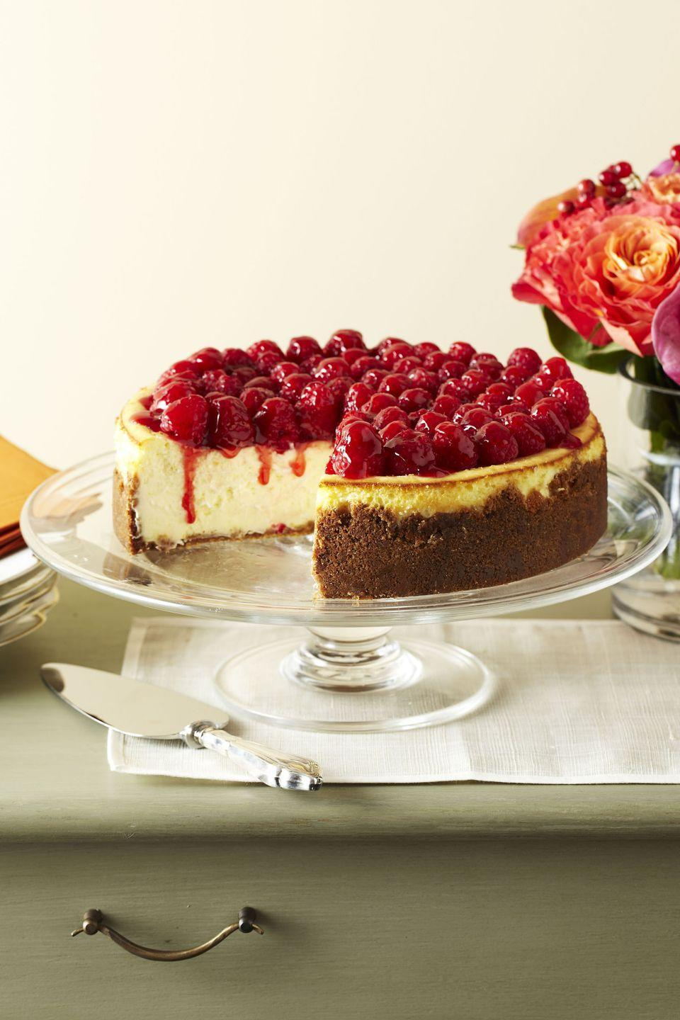 "<p>Add some variety to your dessert table with this <a href=""https://www.goodhousekeeping.com/food-recipes/cooking/g5106/how-to-make-cheesecake/"" rel=""nofollow noopener"" target=""_blank"" data-ylk=""slk:made-from-scratch cheesecake"" class=""link rapid-noclick-resp"">made-from-scratch cheesecake</a>, complete with a gorgeous berry topping. </p><p><em><a href=""https://www.goodhousekeeping.com/food-recipes/a11443/raspberry-cheesecake-recipe-ghk1111/"" rel=""nofollow noopener"" target=""_blank"" data-ylk=""slk:Get the recipe for Raspberry Cheesecake »"" class=""link rapid-noclick-resp"">Get the recipe for Raspberry Cheesecake »</a></em></p><p><strong>RELATED: </strong><a href=""https://www.goodhousekeeping.com/holidays/thanksgiving-ideas/g1532/thanksgiving-desserts/"" rel=""nofollow noopener"" target=""_blank"" data-ylk=""slk:63 Absolutely Incredible Thanksgiving Desserts You Need to Make"" class=""link rapid-noclick-resp"">63 Absolutely Incredible Thanksgiving Desserts You Need to Make</a></p>"