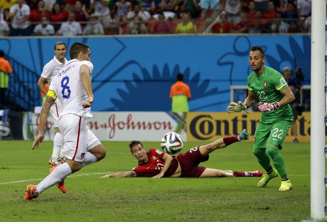 Portugal's goalkeeper Beto watches as United States' Clint Dempsey scores his side's second goal during the group G World Cup soccer match between the USA and Portugal at the Arena da Amazonia in Manaus, Brazil, Sunday, June 22, 2014. (AP Photo/Martin Mejia)