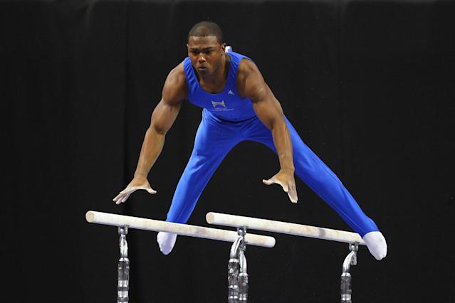 ST. LOUIS, MO - JUNE 9: John Orozco competes on the parallel bars during the Senior Men's competition on Day Three of the Visa Championships at Chaifetz Arena on June 9, 2012 in St. Louis, Missouri. (Photo by Dilip Vishwanat/Getty Images)
