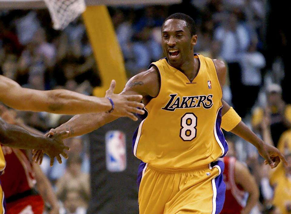 Los Angeles lakers' Kobe Bryant is congratulated after scoring a basket during the second quarter against the Houston Rockets during their NBA Western Conference first-round game Monday, April 28, 2004, at Staples Center in Los Angeles.  (AP Photo/Kevork Djansezian)