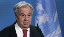 """FILE - In this Dec. 17, 2020 file photo, UN Secretary-General Antonio Guterres addresses the media during a joint press conference in Berlin, Germany. The head of the United Nations is calling for """"immediate, rapid and large-scale"""" cuts in greenhouse gas emissions to curb global warming. Antonio Guterres warned governments ahead of next week's annual U.N. General Assembly that climate change is proceeding faster than predicted and fossil fuel emissions have already bounced back from a pandemic dip. Speaking at the launch of a U.N.-backed report summarizing current efforts to tackle climate change, Guterres said recent extreme weather showed no country is safe from climate-related disasters. (AP Photo/Michael Sohn, pool, File)"""