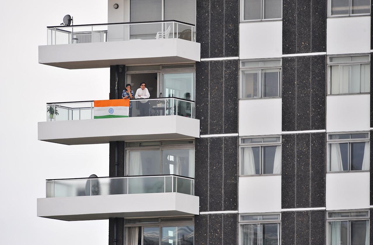 LONDON, ENGLAND - JUNE 14: Indian fans watch from a nearby balcony during the ICC World Twenty20 Super Eights match between England and India at Lord's on June 14, 2009 in London, England.  (Photo by Christopher Lee/Getty Images)